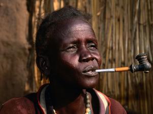 Woman Smoking a Pipe, Gambela, Ethiopia by Ariadne Van Zandbergen