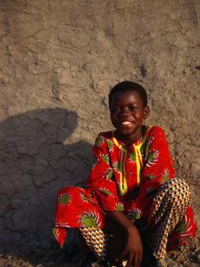 Young Boy Sitting in Front of Wall, Djenne, Mali by Ariadne Van Zandbergen