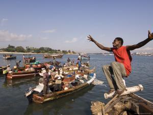 Young Man Clowning Around on Fishing Boat at Kibongoni, Dar Es Salaam, Tanzania by Ariadne Van Zandbergen