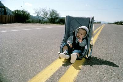 https://imgc.allpostersimages.com/img/posters/arizona-junior-raising-arizona-by-joel-coen-and-ethan-coen-1987-photo_u-L-Q1C2POX0.jpg?artPerspective=n