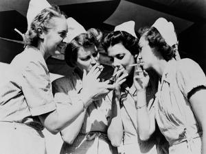 Army Nurses Lighting Up their Cigarettes in 1947