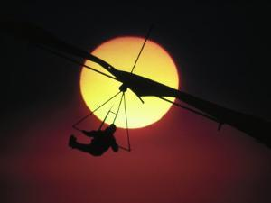 Hang Glider at Sunset by Arnie Rosner