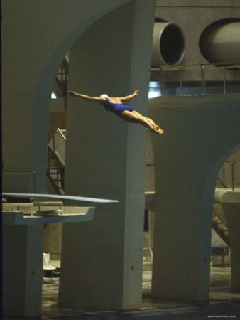 Athlete in Mid Air During a Platform Dive at Summer Olympics by Art Rickerby