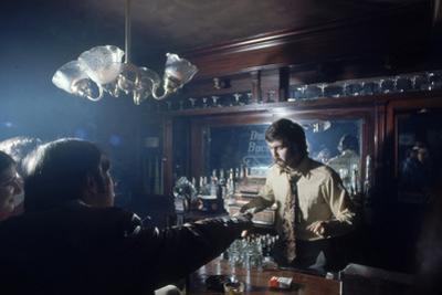 Nhl Boston Bruin Player Derek Sanderson Bartending at His Favorite Boston Bar, 1971 by Art Rickerby