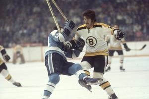 Nhl Boston Bruin Player Derek Sanderson Tripping Pittsburgh Penguin Player During Game by Art Rickerby