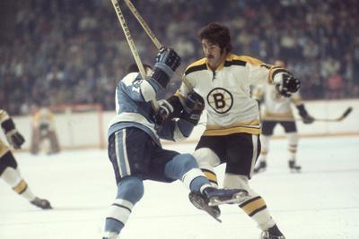 Nhl Boston Bruin Player Derek Sanderson Tripping Pittsburgh Penguin Player During Game