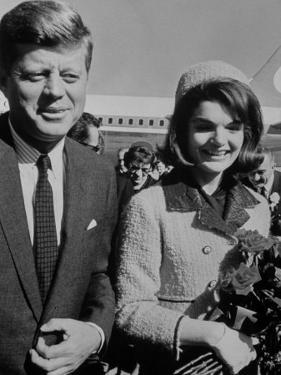 President John F. Kennedy and Wife Arriving at Airport by Art Rickerby