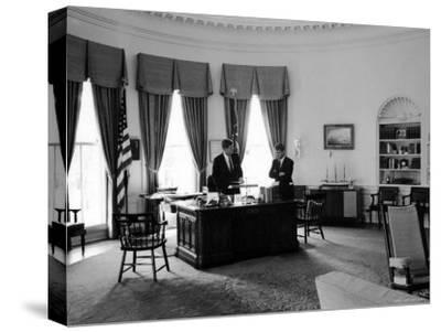 President John F. Kennedy in Oval Office with Brother, Attorney General Robert F. Kennedy by Art Rickerby
