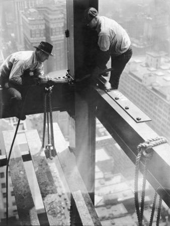 Workers balancing on steel beam above streets during construction of the Manhattan Company Building by Arthur Gerlach