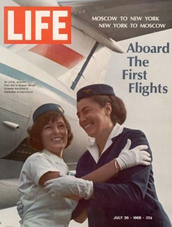 American Pan Am Stewardess Sicari Embracing Russian Aeroflot Stewardess Arutyunova, July 25, 1968 by Arthur Schatz