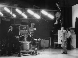 """CBS Cameraman Filming Ed Sullivan During """"The Ed Sullivan Show,"""" Cue Cards are Visible Behind Him by Arthur Schatz"""