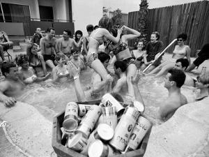 """Pair of Couples """"Chicken Fighting"""" in a Crowded Jacuzzi Pool During a Beer Fueled Party by Arthur Schatz"""