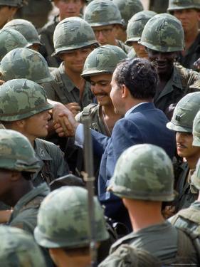 President Richard Nixon with Crowd of US Soldiers During Surprise Visit to War Zone in S. Vietnam by Arthur Schatz