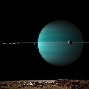 Artist's Depiction of a Ringed Gas Giant Planet Surrounded by it's Moons