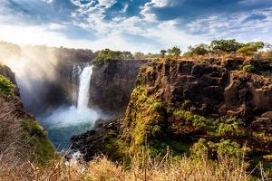 The Victoria Falls is the Largest Curtain of Water in the World (1708 Meters Wide). the Falls and T by Artush