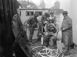 Inspecting the Piles at Tacoma, Diver on Deck in Suit, 1924 by Asahel Curtis