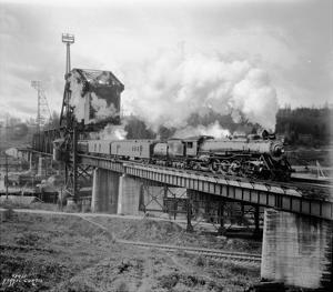 A Great Northern Railway Train on the G.N.R. Bridge across the Lake Washington Ship Canal in Ballar by Ashael Curtis