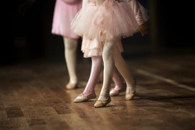 A 3 year old girl on stage at her ballet performance. by Ashima Narain