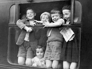 Children Waving While Being Evacuated by Associated Newspapers