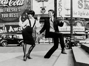 Dancing at Piccadilly Circus by Associated Newspapers