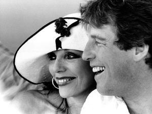 Joan Collins and Bill Wiggins by Associated Newspapers