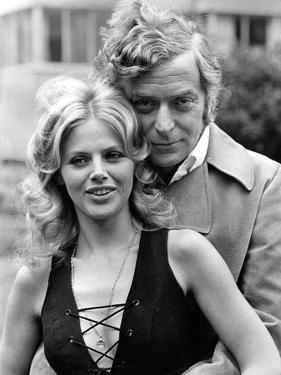 Michael Caine with Britt Ekland by Associated Newspapers