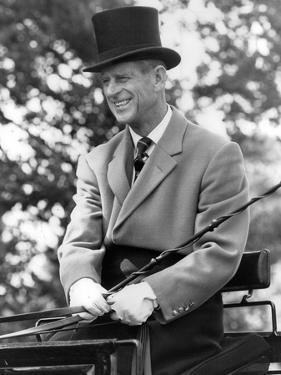 Prince Philip carriage driving at Windsor Horse Show by Associated Newspapers