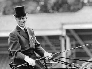 Prince Philip driving a horse drawn carriage by Associated Newspapers