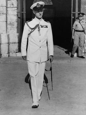 Prince Philip in uniform in Malta to join H.M.S. Chequers by Associated Newspapers