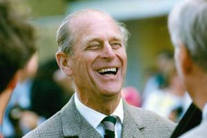 Prince Philip laughs by Associated Newspapers