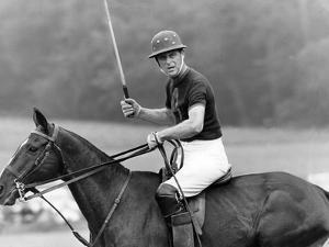 Prince Philip playing polo by Associated Newspapers
