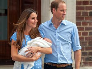 Prince William, Duke of Cambridge and Catherine, Duchess of Cambridge with son, Prince George by Associated Newspapers