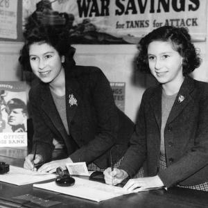 Princess Elizabeth (Queen Elizabeth II) and Princess Margaret at a country post office by Associated Newspapers
