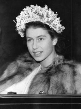 Princess Elizabeth (Queen Elizabeth II) wearing a fur coat by Associated Newspapers