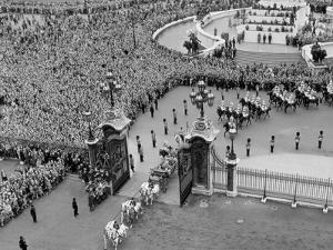 Queen Elizabeth II and Prince Philip arriving at Buckingham Palace by Associated Newspapers