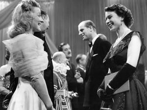 Queen Elizabeth II and Prince Philip at BBC Lime Grove Studios with actress Sally Barnes by Associated Newspapers