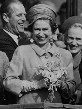 Queen Elizabeth II and The Duke of Edinburgh laughing by Associated Newspapers