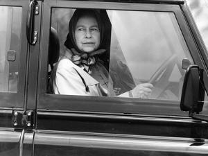Queen Elizabeth II at the wheel of her Land Rover by Associated Newspapers