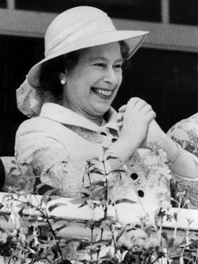 Queen Elizabeth II celebrating a win at the Derby by Associated Newspapers