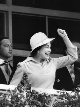 Queen Elizabeth II cheering on her horse at the Derby by Associated Newspapers