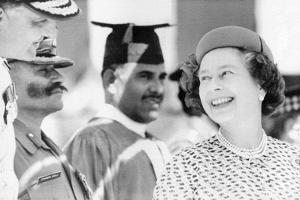 Queen Elizabeth Ii Laughing During Her Tour of India by Associated Newspapers