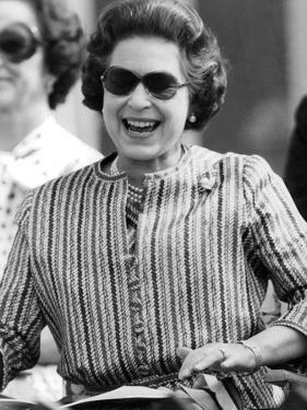 Queen Elizabeth II looking happy at a polo match by Associated Newspapers