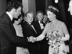 Queen Elizabeth II meeting Tom Jones by Associated Newspapers