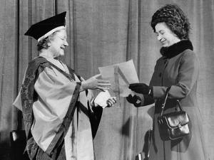 Queen Elizabeth II presents her mother with the degree of Honorary Doctorate of Music by Associated Newspapers