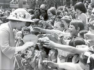 Queen Elizabeth II with crowds at Westminster Cathedral by Associated Newspapers