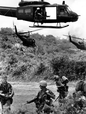 Helicopters Drop Troops by Associated Press