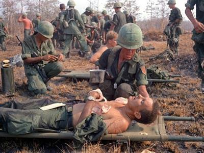 Medics Treat Wounded by Associated Press