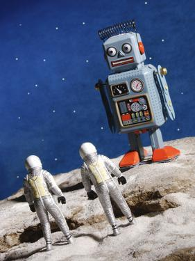Astronaut Figurines Standing Beside Gray Toy Rocket