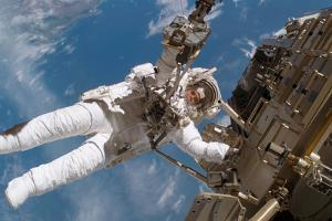Astronaut Fuglesang Performing Spacewalk