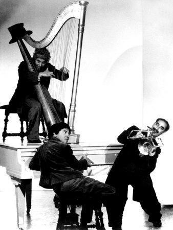 https://imgc.allpostersimages.com/img/posters/at-the-circus-harpo-marx-bottom-chico-marx-groucho-marx-1939_u-L-P6QFJ90.jpg?artPerspective=n